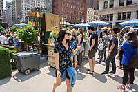 Visitors to Flatiron Plaza in New York receive samples of Nestea brand iced tea at a branding event onSaturday, June 10, 2017.  (© Richard B. Levine)