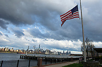 WEST NEW YORK, NJ - APRIL 21:Flags are flying at half-mast as the New York skyline is seen on the background on April 21, 2020 from West New York, New Jersey. (Photo by Kena Betancur/ VIEWpress via Getty Images)