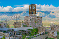 Clocktower and moutains at Gjirokastra Castle, Albania Finest example of Ottoman-style city in Albania   UNESCO World Heritage Site