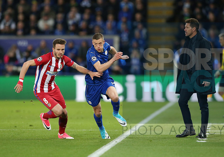 Leicester's Jamie Vardy tussles with Atletico's Saul as Diego Simeone looks on during the Champions League Quarter-Final 2nd leg match at the King Power Stadium, Leicester. Picture date: April 18th, 2017. Pic credit should read: David Klein/Sportimage