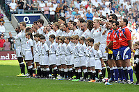 The England team line up for the national anthem. International match between England and the Barbarians on June 1, 2014 at Twickenham Stadium in London, England. Photo by: Patrick Khachfe / Onside Images