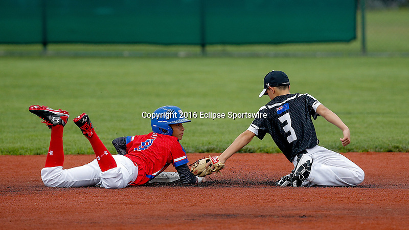 ABERDEEN, MD - AUGUST 01: Nikau Pouka Grego #3 of New Zealand attempts to tag Lucas Torres #11 of Puerto Rico  on a pick off attempt, he is safe during the 1st inning in a game between New Zealand and Puerto Rico during the Cal Ripken World Series at The Ripken Experience Powered by Under Armour on August 1, 2016 in Aberdeen, Maryland. (Photo by Ripken Baseball/Eclipse Sportswire/Getty Images)