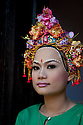 SREY BREY VILLAGE, CAMBODIA-- Chan, 23, wearing traditional headdress and makeup of the Cham (Muslim) minority.