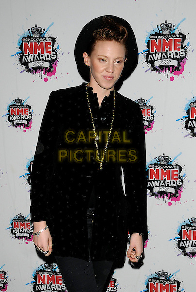 LA ROUX (Eleanor Jackson).The Shockwaves NME Awards 2010 held at Brixton Academy, London, England. .February 24th, 2010.half length black hat jacket polka dot necklace gold.CAP/CAN.©Can Nguyen/Capital Pictures.