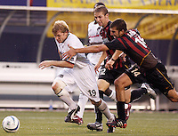 The Burn's Bobby Rhine gets fouled just outside the box by the MetroStars' Kenny Arena as teammate Jeff Parke watches. The Dallas Burn defeated the MetroStars 1-0 at Giant's Stadium, East Rutherford, NJ, on August 15, 2004.