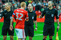 Nottingham Forest's midfielder Ben Watson (32) shakes referee Jeremy Simpson's hand with referees assistant Michael George and referees assistant Nigel Lugg during the Sky Bet Championship match between Nottingham Forest and Derby County at the City Ground, Nottingham, England on 10 March 2018. Photo by Stephen Buckley / PRiME Media Images.