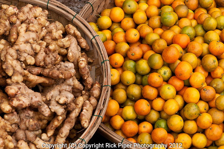 Kumquats and root ginger for sale at the fruit and vegetable market, Bach Dang St, Hoi An, Viet Nam