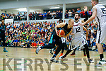 Janis Dumbers Garveys Tralee Warriors in action against Kevin Lacey GS Swords Thunder at the Tralee Sports Complex on Saturday night.