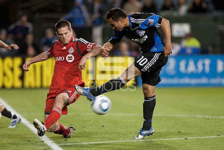 Arturo Alvarez (10) kicks the ball against Sam Cronin (left). Toronto FC defeated the San Jose Earthquakes 3-1 at Buck Shaw Stadium in Santa Clara, California on May 29th, 2010.