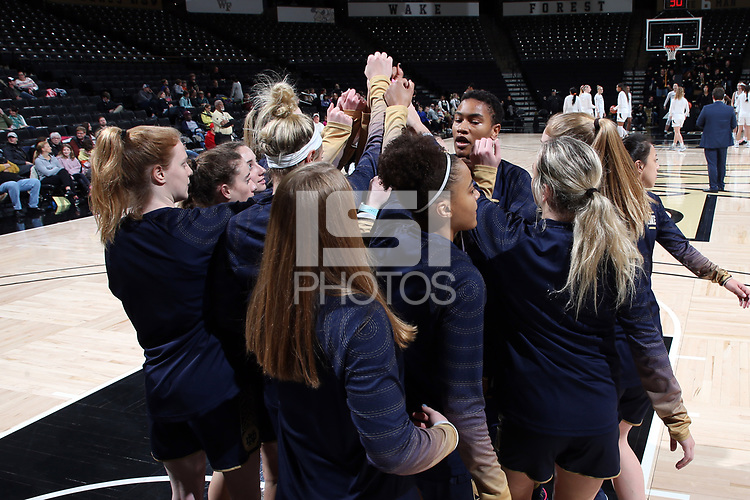 WINSTON-SALEM, NC - FEBRUARY 06: The University of Notre Dame players huddle under the basket during a game between Notre Dame and Wake Forest at Lawrence Joel Veterans Memorial Coliseum on February 06, 2020 in Winston-Salem, North Carolina.