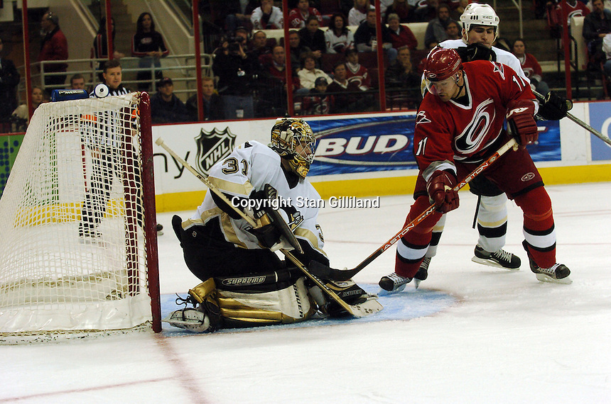 Carolina Hurricanes' Justin Williams is stopped by the Pittsburgh Penguins' goaltender Sebastien Caron in Raleigh, NC Friday, February 10, 2006. The Penguins won the game 4-3...