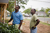 Ray Eurquhartand, right, and Greg Mann work together on the site of a rehabilitated property at the intersection of South and Enterprise, which historically has been the site of many a shooting, holdup and drug deal.