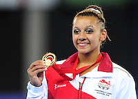 England's Rebecca Downie with her gymnastics artistic women's uneven bars final gold medal<br /> <br /> Photographer Chris Vaughan/CameraSport<br /> <br /> 20th Commonwealth Games - Day 8 - Thursday 31st July 2014 - Gymnastics - The SSE Hydro - Glasgow - UK<br /> <br /> © CameraSport - 43 Linden Ave. Countesthorpe. Leicester. England. LE8 5PG - Tel: +44 (0) 116 277 4147 - admin@camerasport.com - www.camerasport.com