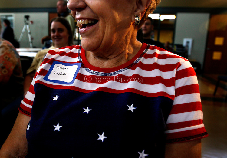 A woman laughs at a joke by Republican Presidential candidate Mitt Romney (R-MA) in Spencer, IA, on July 20, 2007. ..