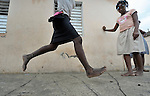 Girls play hopscotch in Batey Bombita, a community in the southwest of the Dominican Republic whose population is composed of Haitian immigrants and their descendents.