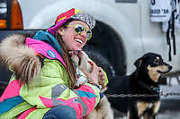 Monica Zappa poses with a dog just prior to the Ceremonial Start of the 2016 Iditarod in Anchorage, Alaska.  March 05, 2016