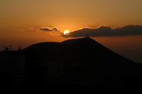 Sun rising above  acloud and mountain, San Miguel countryside, Tenerife, Canary Islands, Spain