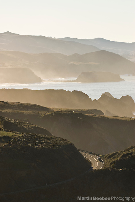 Car driving on Highway 1 along the Sonoma County coast, California