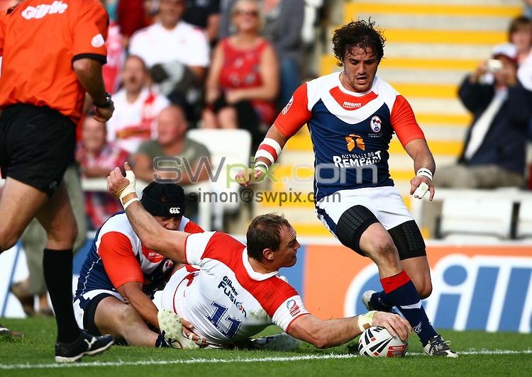 PICTURE BY VAUGHN RIDLEY/SWPIX.COM - Rugby League - International - England v France - Leigh Sports Village, Leigh, England - 12/06/10...Copyright - Simon Wilkinson - 07811267706...England's Gareth Ellis scores a try.