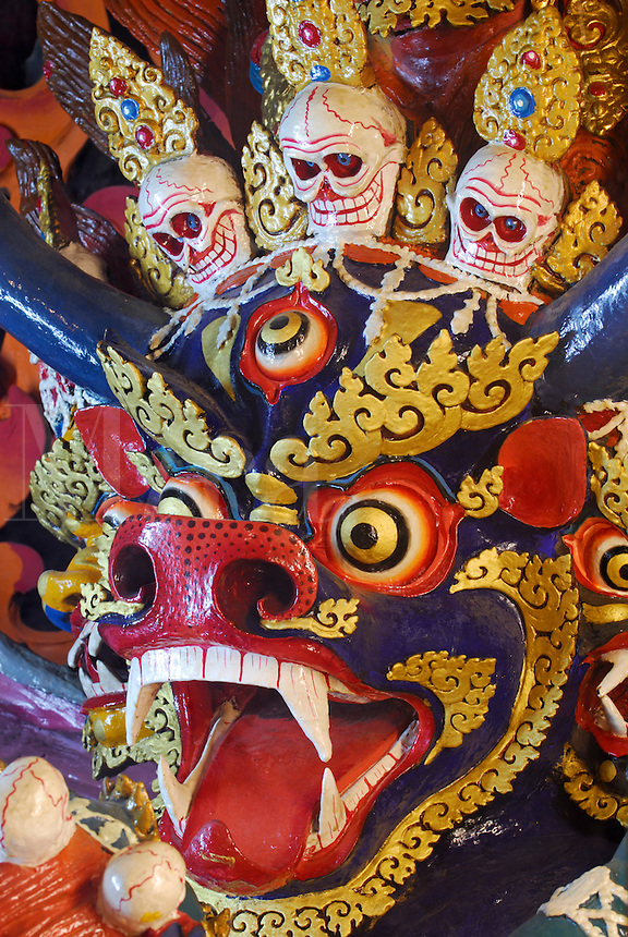 Yamantaka, Dorje Jigje in Tibetan, Lord of Death, eight -headed  protector deity of the Gelugpa order, the main one, the head of a blue bull festooned with skulls, guards a chapel at Drepung Monastery, Lhasa, Tibet, China..