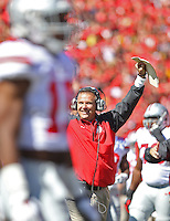 Urban Meyer throws his hands up in celebration ofOhio State Buckeyes wide receiver Michael Thomas (3) second quarter TD at Byrd Stadium on October 4, 2014.  (Chris Russell/Dispatch Photo)