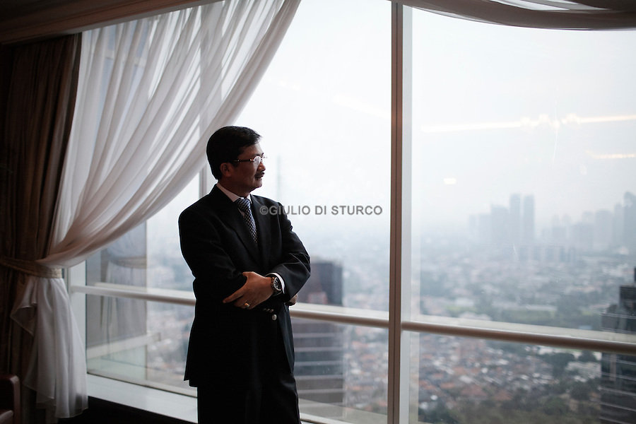 JAKARTA, INDONESIA, MAY 2013:<br /> Rudi Rubiandini the head of Oil and Gas task force, in his office in Jakarta, may 2013.<br /> © Giulio Di Sturco for Bloomberg Markets