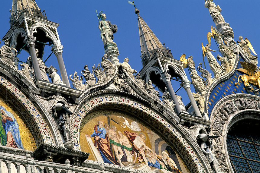 Close up of gold and artwork of the  front of the Famous St Marks Church in San Marcos Plaza in romantic Venice Ital