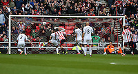 Pictured: A shot by a Sunderland player bounced down from the Swansea crossbar and then kicked away by Neil Taylor (2nd L). Sunday 11 May 2014<br /> Re: Barclay's Premier League, Sunderland v Swansea City FC at the Stadium of Light, Sunderland, UK.