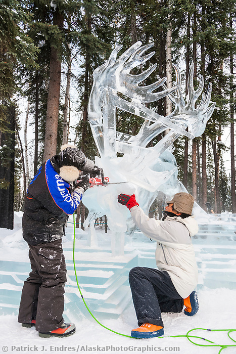 "Junichi Nakamura, Japan, works on the antlers of a caribou for the multi block sculpture titled ""White Fang"" for the 2009 World Ice Art Championships in Fairbanks, Alaska. Team members: Junichi Nakamura, Shinichi Sawamura, Fukumi Furukawa, Takao Waki."