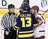 Matt Reigert, Mike Collins (Merrimack - 13), Steven Whitney (BC - 21) - The Boston College Eagles defeated the Merrimack College Warriors 4-2 to give Head Coach Jerry York his 900th collegiate win on Friday, February 17, 2012, at Kelley Rink at Conte Forum in Chestnut Hill, Massachusetts.
