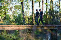 Adam Scott (AUS) and Henrik Stenson (SWE) depart the 10th tee over the bridge during round 2 of the Shell Houston Open, Golf Club of Houston, Houston, Texas, USA. 3/31/2017.<br /> Picture: Golffile | Ken Murray<br /> <br /> <br /> All photo usage must carry mandatory copyright credit (&copy; Golffile | Ken Murray)
