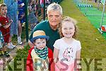 Eugie O'Sullivan, Jack Lawlor and Grace O'Sullivan enjoying the Pig racing in the Ballyheigue GAA field on Thursday.