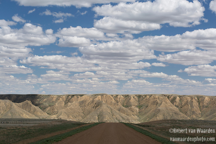 A road near the South Saskatchewan River with the Badlands in the background. The proposed Energy East pipeline would cross the South Saskatchewan and many other prominent rivers in its' voyage towards the East Coast. (Credit: Robert van Waarden - http://alongthepipeline.com)