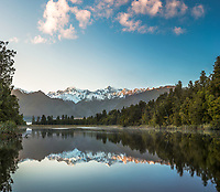 Sunrise at Lake Matheson with Aoraki Mount Cook and Mount Tasman of Southern Alps, Westland Tai Poutini National Park, UNESCO World Heritage Area, West Coast, New Zealand, NZ