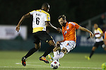 19 April 2014: Carolina's Zack Schilawski (right) and Fort Lauderdale's Chris Nurse (GUY) (6). The Carolina RailHawks played the Fort Lauderdale Strikers at WakeMed Stadium in Cary, North Carolina in a 2014 North American Soccer League Spring Season match. Carolina won the game 4-1.