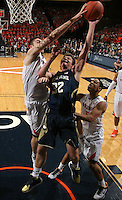 Notre Dame guard Steve Vasturia (32) is blocked by Virginia forward/center Mike Tobey (10) during the game Saturday, February 22, 2014,  in Charlottesville, VA. Virginia won 70-49.