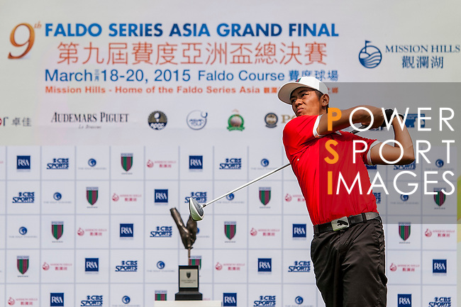 Nguyen Huy Thang of Vietnam tees off at tee one during the 9th Faldo Series Asia Grand Final 2014 golf tournament on March 18, 2015 at Mission Hills Golf Club in Shenzhen, China. Photo by Xaume Olleros / Power Sport Images