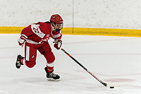 WORCESTER, MA - FEBRUARY 08: Rachel Allen #22 of Boston University brings the puck forward during a game between Boston University and College of the Holy Cross at Hart Center Rink on February 08, 2020 in Worcester, Massachusetts.