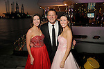 "Tilman Fertitta with Sarah Johnson and Anna Johnson at the San Luis Salute ""Space Pirates"" VIP reception Friday February 24,2017. (Dave Rossman Photo)"