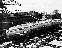 BNPS.co.uk (01202 558833)<br /> Pic Lawrences/BNPS<br /> <br /> The captured German U-Boat UC5 after she ran aground and was salvaged off Scotland in 1916.<br /> <br /> Fascinating early photos of submarine warfare featuring close quarters views of German battleships have come to light 100 years later.<br /> <br /> The photo albums were collated by British Commander Maurice Bailward who documented every stage of his naval career.<br /> <br /> Cmdr Bailward attended Royal Naval College in Osborne, Isle of Wight, from 1906 and 1908, the same time as Edward, the Prince of Wales.<br /> <br /> He was involved in many of the major sea battles of World War Two as well as the British effort to help the Whites during the Russian Civil War of 1919.<br /> <br /> The albums have emerged for sale at auction from a family descendant with Lawrences Auctioneers, of Crewkerne, Somerset.