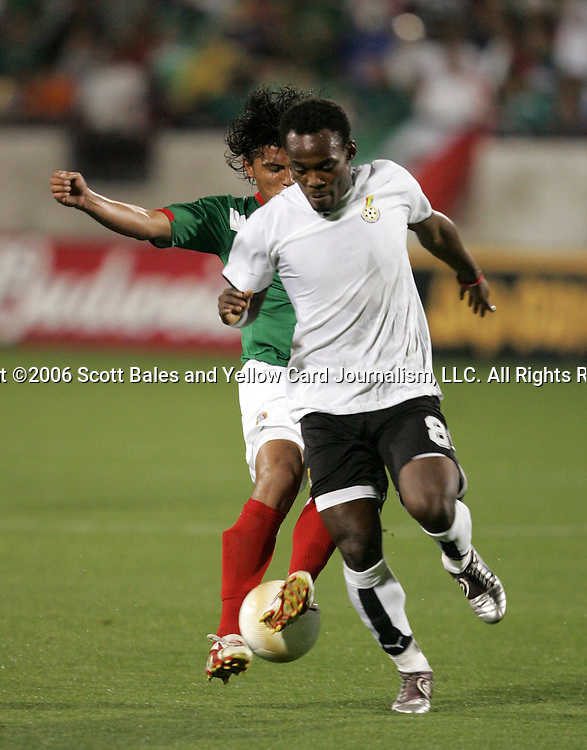 1 March 2006: Ghana's Michael Essien (8) is stripped of the ball by Mexico's Diego Martinez (behind). The National Team of Mexico defeated the National Team of Ghana 1-0 at Pizza Hut Park in Frisco, Texas in an International Friendly soccer match.