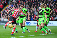 Lincoln City's Harry Anderson gets a shot on target under pressure from Forest Green Rovers' Joseph Mills<br /> <br /> Photographer Andrew Vaughan/CameraSport<br /> <br /> The EFL Sky Bet League Two - Lincoln City v Forest Green Rovers - Saturday 3rd November 2018 - Sincil Bank - Lincoln<br /> <br /> World Copyright © 2018 CameraSport. All rights reserved. 43 Linden Ave. Countesthorpe. Leicester. England. LE8 5PG - Tel: +44 (0) 116 277 4147 - admin@camerasport.com - www.camerasport.com