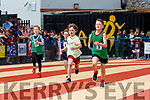 Alex Guerin Ryan Castleisland (white vest) stays ahead of his Kilcummin, Killorglin adn Milltown-Listry opponents  at the Kerry Community games finals in Castleisland on  Saturday