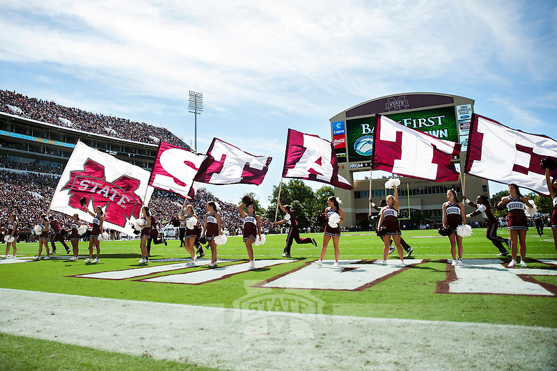 Cheerleaders with State flags in the endzone after a touchdown.(photo by Keats Haupt / © Mississippi State University)