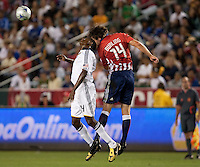 Edson Buddle (left) goes up for the header against Bobby Burling (14). The LA Galaxy defeated Chivas USA 1-0 at Home Depot Center stadium in Carson, California Saturday evening July 11, 2009.