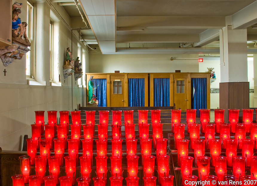 Confessionals and votive light at the National Shrine of Our Lady of Consolations in Carey , OH