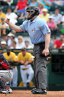 Home plate umpire Bill Welke makes a call in a spring training game between the Pittsburgh Pirates and Minnesota Twins at McKechnie Field on March 10, 2012 in Bradenton, Florida.  Minnesota defeated Pittsburgh 4-2.  (Mike Janes/Four Seam Images)