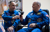 Expedition 54 Soyuz Commander Anton Shkaplerov of Roscosmos, left, passes a microphone to flight engineer Scott Tingle of NASA, right, while answering a question during a press conference, Saturday, December 16, 2017 at the Cosmonaut Hotel in Baikonur, Kazakhstan. Expedition 54 Soyuz Commander Anton Shkaplerov of Roscosmos, flight engineer Scott Tingle of NASA, and flight engineer Norishige Kanai of Japan Aerospace Exploration Agency (JAXA) are scheduled to launch to the International Space Station aboard the Soyuz spacecraft from the Baikonur Cosmodrome on December 17.  <br /> Mandatory Credit: Joel Kowsky / NASA via CNP