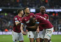 West Ham United's Javier Hernandez celebrates scoring his side's fourth goal with Angelo Ogbonna, Manuel Lanzini and Issa Diop<br /> <br /> Photographer Rob Newell/CameraSport<br /> <br /> The Premier League - West Ham United v Huddersfield Town - Saturday 16th March 2019 - London Stadium - London<br /> <br /> World Copyright © 2019 CameraSport. All rights reserved. 43 Linden Ave. Countesthorpe. Leicester. England. LE8 5PG - Tel: +44 (0) 116 277 4147 - admin@camerasport.com - www.camerasport.com