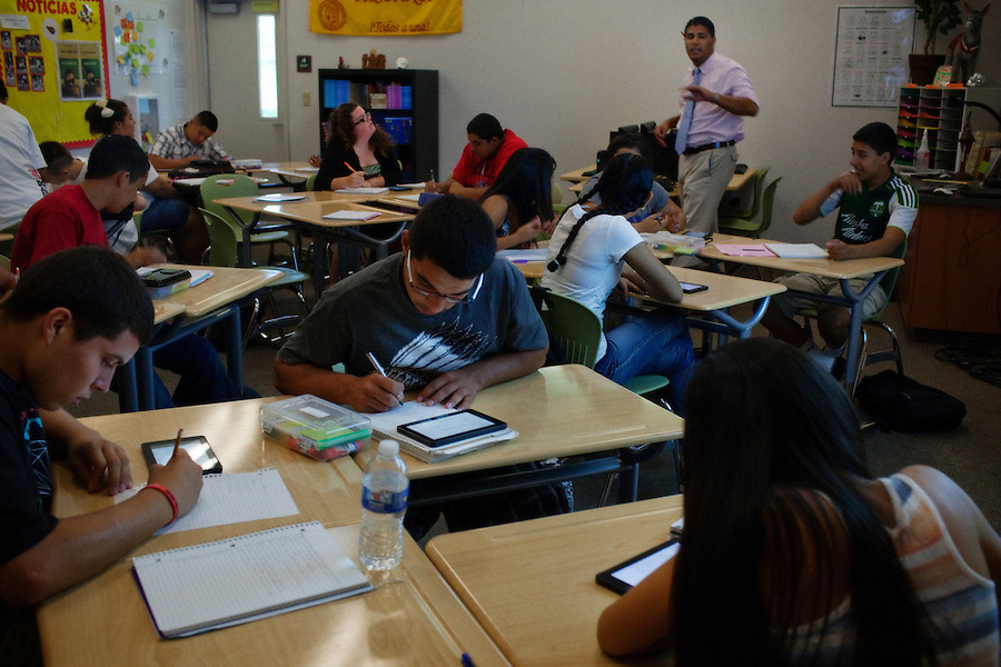 """Lindsay, California, September 5, 2012 - Students in Adrian Gutierrez's Spanish I class use Kindles to do course work. Principal Jaime Robles says that the school used to ban phones and and tablets, but now they embrace them. This is how students communicate and learn. So we are using the tools that they use to keep them engaged.""""..Lindsay High School began building a competency-based education model about 7 years ago, fully implementing it just over three years ago and is set to graduate its first class this school year. This model does away with traditional grading and pass/fail for grades. Instead students are expected to achieve proficiency in a range of areas in each class, where a 3 (equal to a traditional B) is passing; A 4 is considered intensive and usually denotes college bound. Says Principal Jaime Robles, ?This allows students to learn at there own pace. If a student is advanced, they can move ahead, and if a student is lagging, they get the support they need.? Part of this model allows for students who are more advanced dig deeper and push harder and truly move ahead of others. Because they are ahead, some spend the extra time learning more, others take concurrent classes at the nearby community college and some choose to graduate early to start their path. ?Each student has their own set of goals,? says English teacher Amalia Lopez, ?Whatever their goals are, we support them.?.Slug: DD_ CompetencyByline: Daryl Peveto / LUCEO for Education Week"""